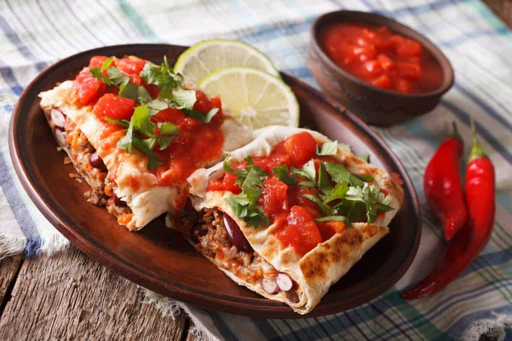 Chimichanga With Minced Meat, Vegetables And Cheese Close-up Hor
