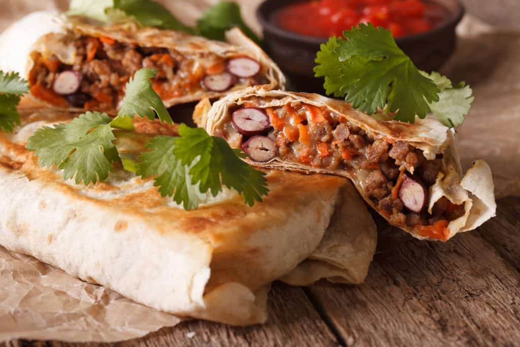Chimichanga With Ground Meat, Beans And Cheese Macro. Horizontal