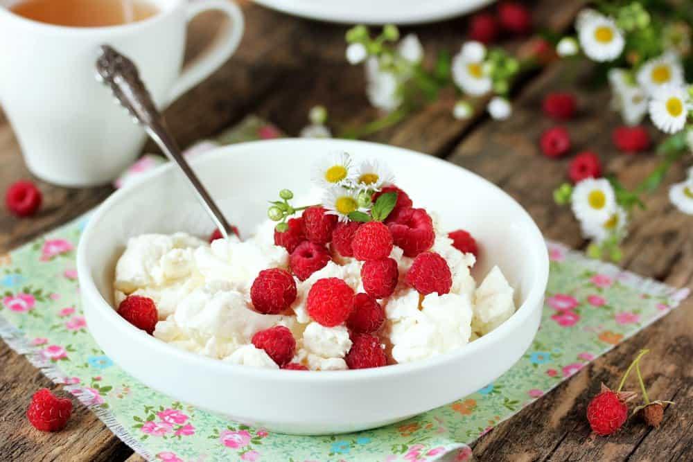 Fresh cottage cheese with juicy berries raspberries
